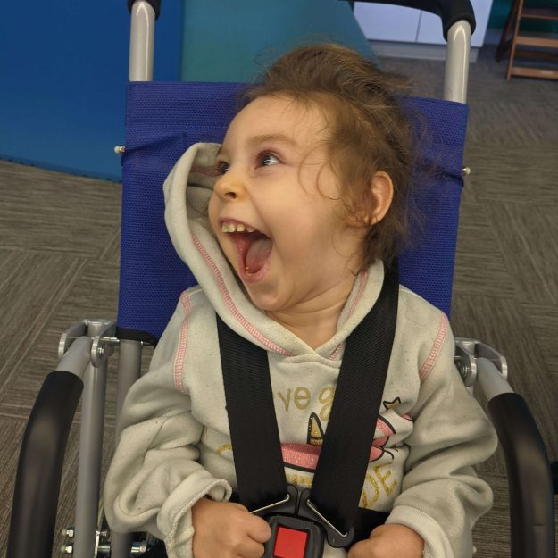 happy girl in wheelchair